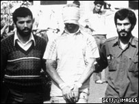 A US hostage and his Iranian captors