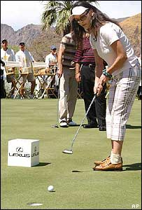 Catherine Zeta Jones playing golf