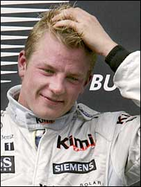 Kimi Raikkonen scratches his head