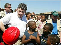 Gordon Brown talks to children in Langa, Cape Town