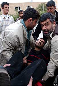 Injured man is carried away after the blast