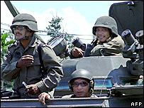 Thai paramilitary troopers patrol the streets in an armoured personnel carrier in Thailand's violence-torn Yala province, 26 August 2005.