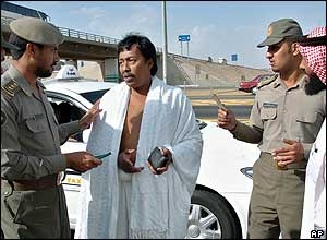 Saudi police detain a Malaysian pilgrim who did not have the correct papers at al-Shemesi check point near the border of the Hajj area