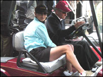 Jones and Douglas in their golfing buggy