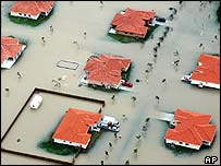 Homes in Miami-Dade County are flooded by heavy rain from Hurricane Katrina