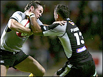 Mark van Gisbergen (left) is tackled by Sonny Parker of the Ospreys