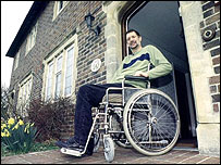 Photo of wheelchair user outside front door
