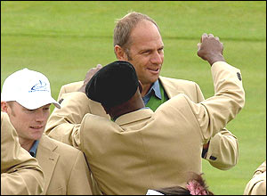 Former footballer Ian Wright helps Sir Steve Redgrave with his blazer