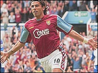 Milan Baros celebrates scoring on his debut for Aston Villa