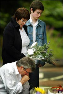 Rory Blackhall's family laying flowers