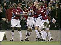 Burnley's players celebrate after Traore's own goal