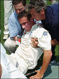 Simon Jones is helped off the field after injuring himself at the Gabba in 2002
