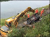 Car being removed from crash site in Looe
