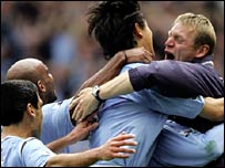 Stuart Pearce (r) celebrates Andy Cole's winner against Portsmouth