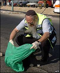 Israeli paramedic collecting remains of bomber