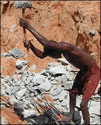 Man destroying wall foundations in Mogadishu