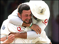 Steve Harmison is hugged by a team-mate