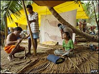 Tribespeople build a shelter on Nicobar island