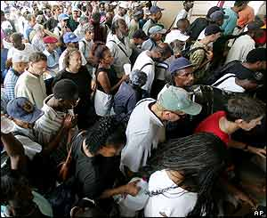Residents queue to take shelter inside the Superdome