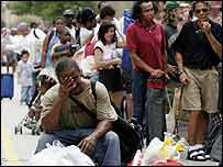 People queue to take shelter in the Superdome, New Orleans, 28 August 2005