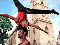 Acrobats outside church