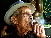 Musician from Cuba's Buena Vista Social Club, Francisco Repilado, smoking a cigar