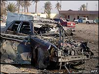 A destroyed vehicle in Baiji, oil-producing city in northern Iraq