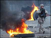 A US soldier walks through debris left by a massive car bomb that exploded near the Australian Embassy in the al-Karrada neighbourhood of Baghdad on 19 January