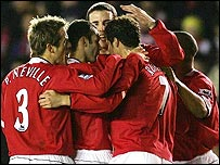 Manchester United's players celebrate Cristiano Ronaldo's goal
