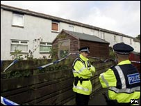 Police guard the Camps Rigg house