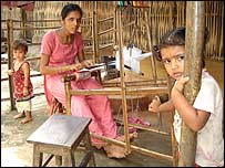 Refugee woman weaving