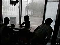 Hotel guests watch the storm at the Best Western hotel, New Orleans