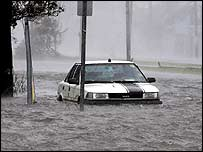 Flood waters surround a car in New Orleans.