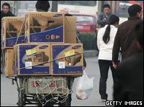 Man transporting computer monitors, Getty Images