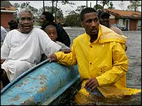 Rescuer helps residents through the floodwaters in Gulfport, Mississippi