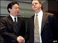 Chinese vice commerce minister Gao Hucheng (left) and US trade official David Spooner
