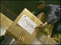 Worker arranges ballot boxes at a warehouse at Baghdad's International Airport