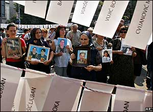Serbian women display photos of relatives missing in the 1991-99 Balkan wars, outside the Croatian embassy in Belgrade