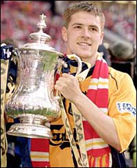 Michael Owen holds the FA Cup after victory at the Millennium Stadium, Cardiff