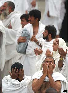 Pilgrims pray after throwing stones at a pillar representing the devil in Mina outside Mecca, Saudi Arabia on Thursday