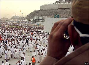 A Saudi policeman watches pilgrims who perform a symbolic stoning of the devil in Mina, Saudi Arabia