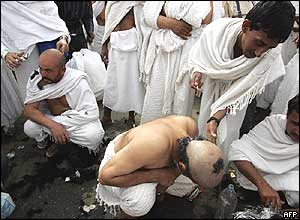 Pilgrims have their hair shaved on Thursday after throwing stones at pillars representing Satan in Mina, Saudi Arabia
