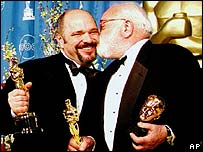 Saul Zaentz (right) and Anthony Minghella at the Oscars 1997