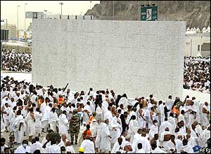 Pilgrims stone a wall representing Satan in the Mina valley, just outside the Saudi holy city of Mecca