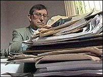 Image of a GP with paperwork