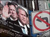 George W Bush's inauguration is broadcast on a large screen in Times Square, New York