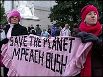 Anti-war protestors hold an 'Impeach Bush' sign