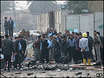 Iraqis gather at the site of a car bombing in Iraq