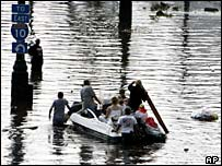 People in flooded New Orleans take to a boat