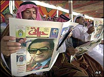 A Bedouin tribal leader reads an Egyptian newspaper